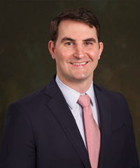 Dr. Andrew Gunter Cain who is an Anesthesiologist specializing in non-surgical spine care and Fellowship-trained in Interventional Spine